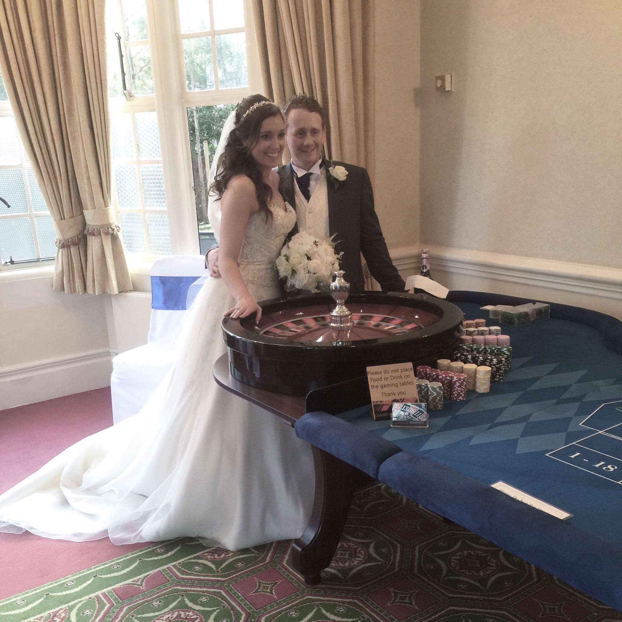 bride and groom at roulette table