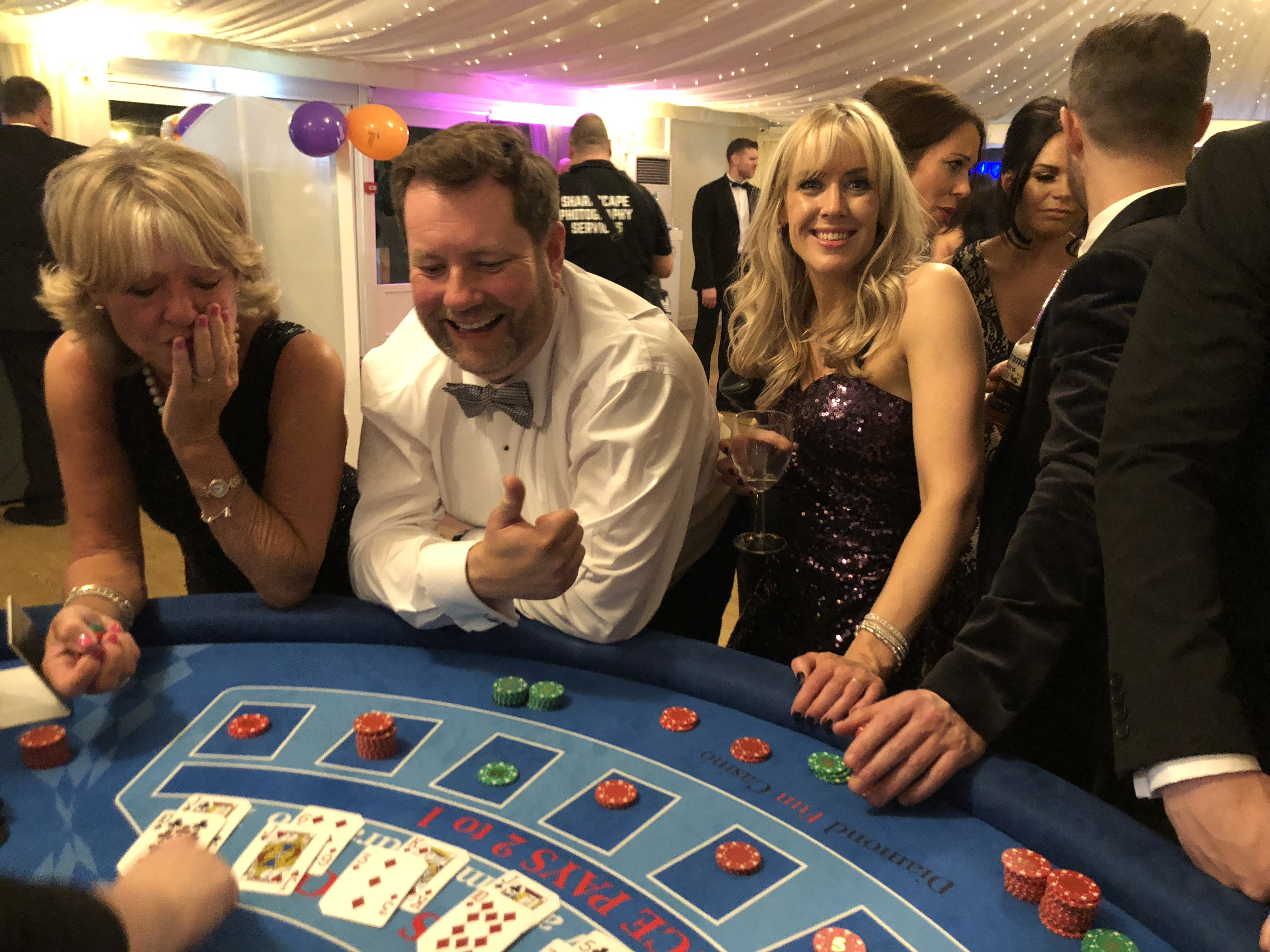 dealer checking poker hands